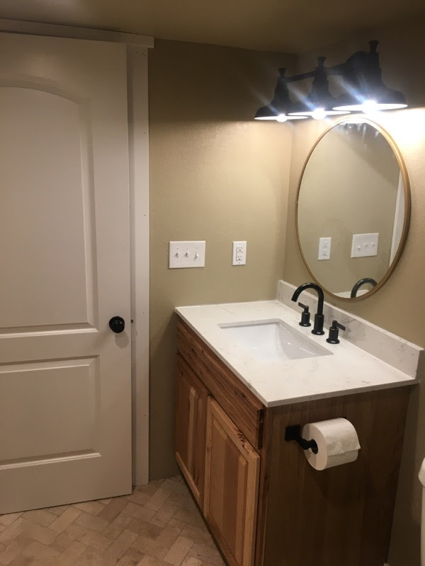 cute bathroom in a newer basement remodeling project - NoCo Basements